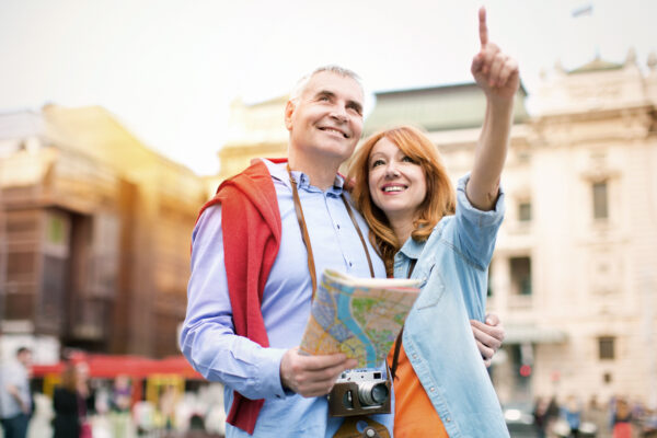 Mature couple traveling, sightseeing in European city.