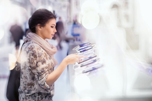 Woman looking at smartphones in store!